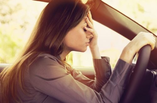 stressed woman in driver's seat