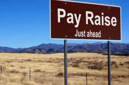 pay raise road sign